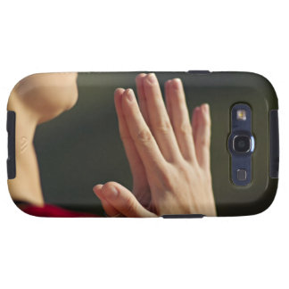 33 year old woman sits in meditation on a cliff galaxy SIII cases