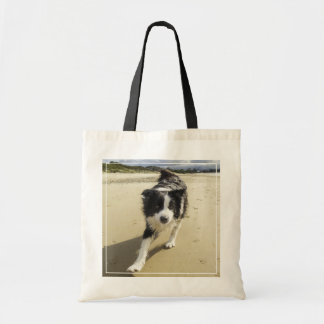 A Border Collie Dog Running On The Beach Tote Bag