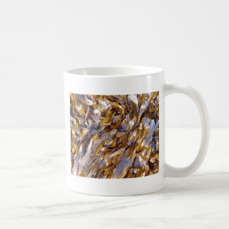 A brown seaweed on the surface of the sea. basic white mug