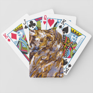 A brown seaweed on the surface of the sea. playing cards