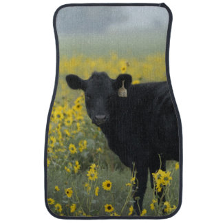 A calf amid the sunflowers of the Nebraska Car Mat