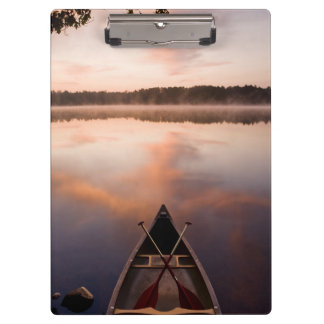 A canoe rests on the shore of Pawtuckaway Lake Clipboard