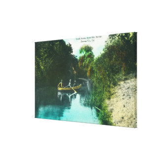 A Creek Scene with Family in a Canoe Canvas Print