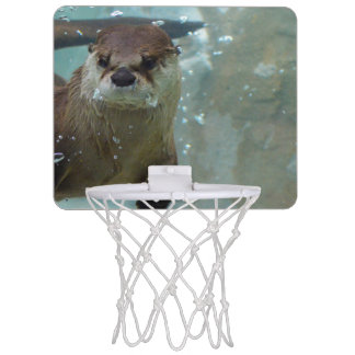 A cute Brown otter swimming in a clear blue pool Mini Basketball Hoop