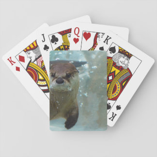 A cute Brown otter swimming in a clear blue pool Playing Cards