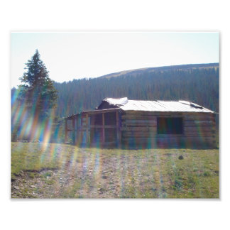 A deserted cabin in the mountains. photographic print
