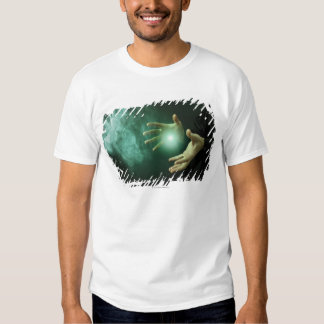A fantasy wizard making magic with his hands. tee shirt