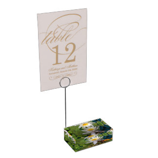 A frog under a flower of water lily table card holder