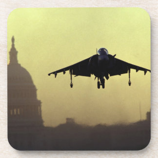 A Harrier jet landing on the Mall at dawn with Coaster