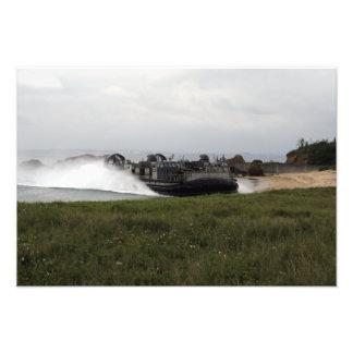 A landing craft air cushion comes ashore photographic print
