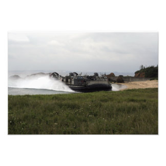 A landing craft air cushion comes ashore photographic print