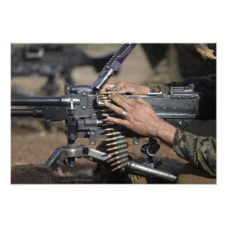 A Marine loads a M-240G machine gun Photo Print