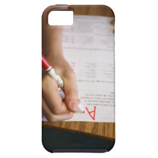 A middle school teacher puts a grade on a iPhone 5 covers