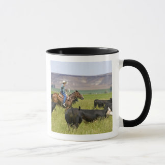 A rancher on horseback during a cattle roundup 2 mug