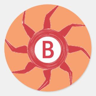 A Red Sun Design on an Orange Background Classic Round Sticker
