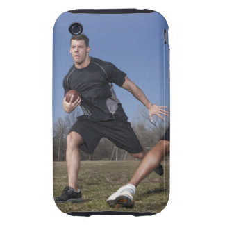 A running play during a touch football game. iPhone 3 tough covers