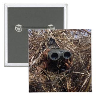 A scout observer practices observation techniqu 15 cm square badge
