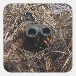 A scout observer practices observation techniqu square sticker