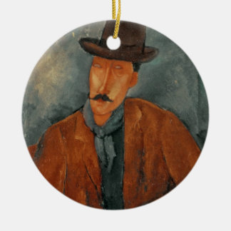 A seated man leaning on a table christmas ornament