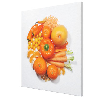 A selection of orange fruits & vegetables. gallery wrap canvas