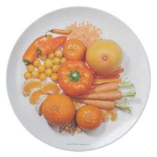 A selection of orange fruits & vegetables. party plates