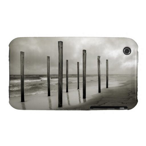 A sepia toned shot of old beach posts iPhone 3 cases