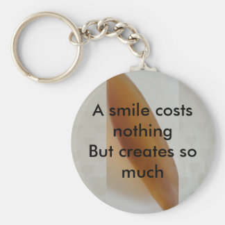 A smile costs nothing basic round button key ring