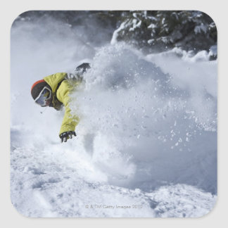 A snowboarder rips untracked powder turns in 2 square sticker