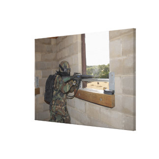 A soldier acts as an opposition force canvas print