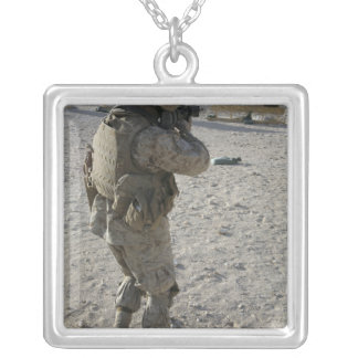 A soldier engages his target on a shooting rang square pendant necklace