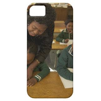 A teacher assists young schoolchildren in her iPhone 5 cases