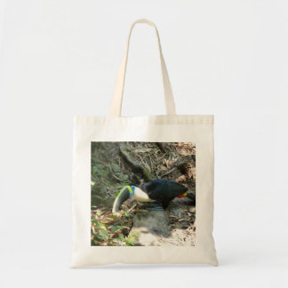 A Toucan Perches on tree roots on the forest floor Tote Bag