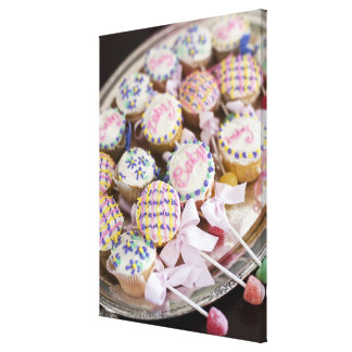 A tray of baby rattle cupcakes at a baby shower. stretched canvas prints