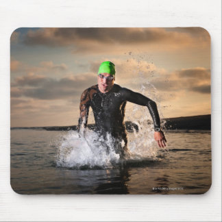 A triathlete at the ocean mouse pad