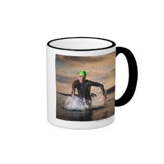 A triathlete at the ocean mug