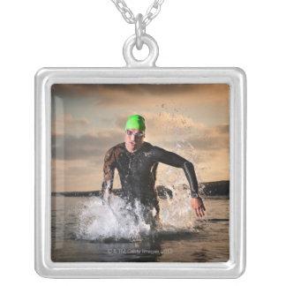 A triathlete at the ocean square pendant necklace