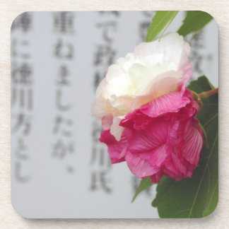 A white a pink flower and Japanese characters Beverage Coasters