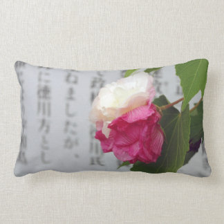 A white a pink flower and Japanese characters Throw Pillows