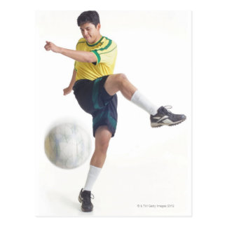 a young latin male wears a yellow soccer jersey postcard