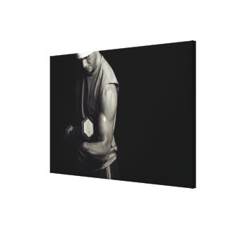 A young man lifts weights. canvas print
