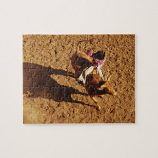 Above View of a Cowboy Riding a Bull Jigsaw Puzzle