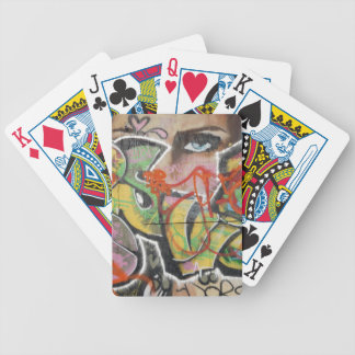 abstract graffiti art mural text type womans face bicycle playing cards