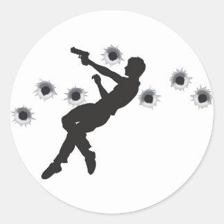 Action hero in gun fight silhouette round sticker