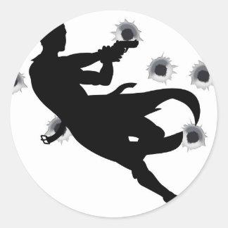 Action hero in gun fight silhouette round stickers