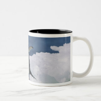 Adelie penguin leaping from iceberg Two-Tone coffee mug