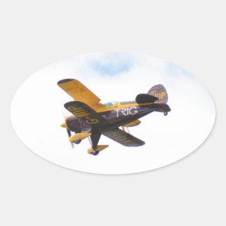 Aerobatic Biplane In Flight Oval Sticker