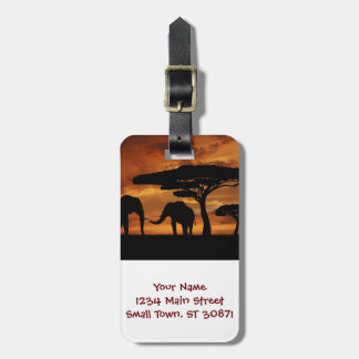 African elephants silhouettes in sunset bag tag