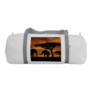 African elephants silhouettes in sunset gym duffel bag