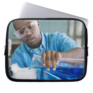 African man performing experiment in chemistry laptop sleeve