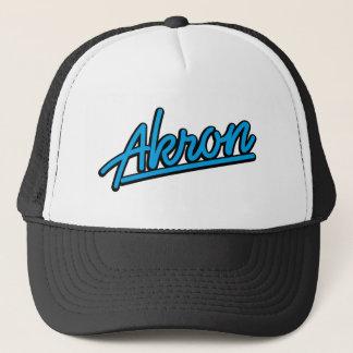 Akron in cyan trucker hat